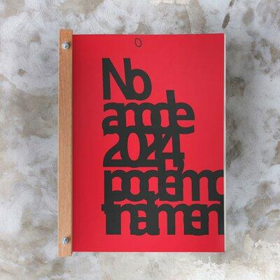 """Livro de serigrafias com capa vermelha e preta onde lê-se: """"No ano de 2024 poderemos"""""""
